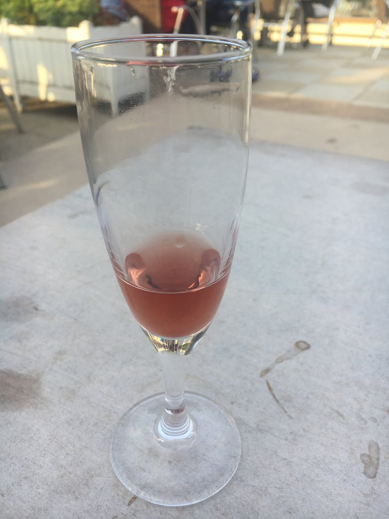 A glass of kir, nearly empty